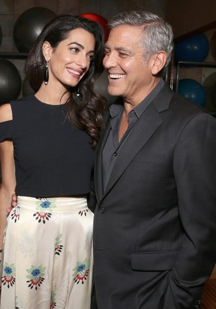 39030e4e00000578-3817880-that_look_of_love_amal_looked_absolutely_smitten_as_she_gazed_to-m-26_1475384610810