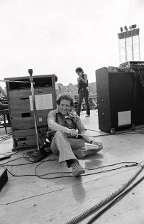 Photographer Baron Wolman is photographed by Bill Graham during the Woodstock Festival, Bethel, NY, August 1969.