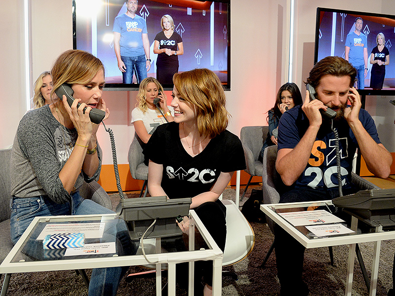 Kristen Wiig, Emma Stone, and Bradley Cooper.