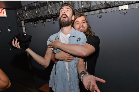 Bastille band members Kyle Simmons and Chris Wood hugged it out at the NYLON Nights x Stillhouse whiskey event.