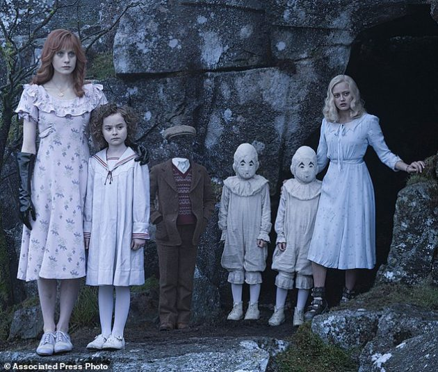 """FILE - In this image released by 20th Century Fox, from left, Lauren McCrostie, Pixie Davies, Cameron King, Thomas and Joseph Odwell and Ella Purnell appear in a scene from, """"Miss Peregrine's Home for Peculiar Children"""". In a crowded autumn weekend at the box office, """"Miss Peregrine's Home for Peculiar Children"""" came out on top. (Jay Maidment/20th Century Fox via AP, File)"""