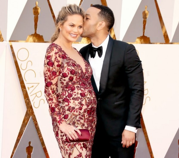 Chrissy Teigen and John Legend attend the 88th Annual Academy Awards