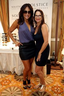TV personality Carrie Ann Inaba poses with Director of Public Relations Solstice Sunglasses/Safilo Eden Wexler.